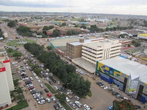One of Lusaka's many confusing roundabouts clearly shows the Friday afternoon rush hour, complete with the blue minibuses you find throughout the city