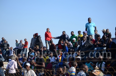 Fans cheer during the match
