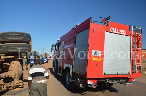 A fire truck arrives on the scene of the accident