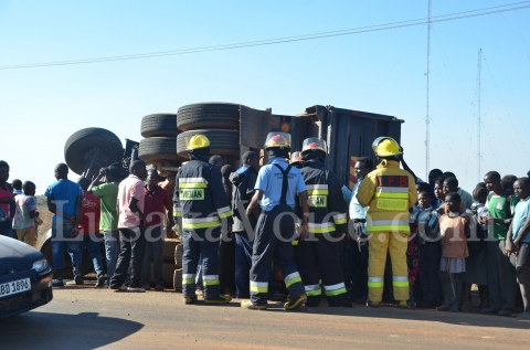 Firefighters inspect the accident and question the driver