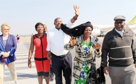 FELIX Ngoma (centre) being welcomed by UN resident coordinator Janet Rogan (left), his wife Mary (second left), his mother Halesi Chima, and Ministry of Foreign Affairs permanent secretary George Zulu at Kenneth Kaunda International Airport in Lusaka yesterday. - Picture by ANGELA MWENDA