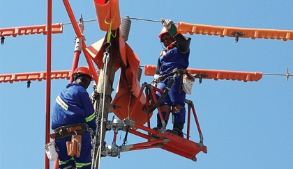 FEMALE Zesco employees demonstrating the new technology of carrying out maintenance works without power disruption at the just-ended Zambia International Trade Fair. - Picture courtesy of Zesco.