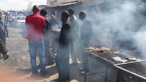 HH , 30th July 2014, at Thornpark market (ku Chusi) having lunch with the people