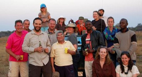 Teachers- Mr Morgan, left, taught for two years at Lusaka International School in Zambia. He is pictured with other members of staff on a day out in the Zambian bush
