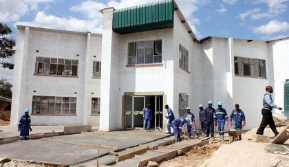 Zambia Forestry College in Kitwe. Above the contractor working on the female dormitory, which is being built at a cost of K5.3 million at the institution. - Picture by NKOMBO KACHEMBA