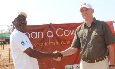 1 'Loan a Cow' beneficiary Chibombo farmer Gillard Shakete shaking hands with ZANACO CEO Bruce Dick