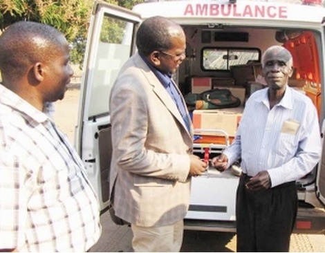 DEPUTY Minister of Health Chitalu Chilufya (centre) presents an Ambulance to Chief Nabwalya (right) of the Bisa speaking people in Mpika on Thursday. Looking on is Mfuwe Member of Parliament Mwimba Malama. – Picture by NANCY SIAME.