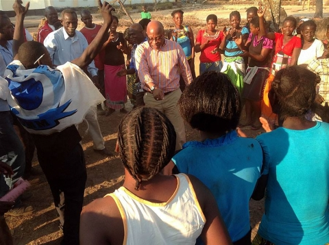 Dr Nevers Mumba dancing with supporters, Mangango