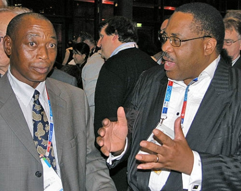Lewis Ncube (right is chatting with former FIDE African president Dabilani Buthali at the 2008 Chess Olympiad