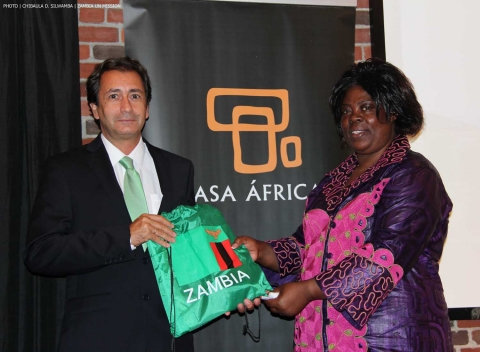 Minister of Tourism and Arts Jean Kapata giving a Zambia's Golden Jubilee souvenir to Spain's Casa África General-Director Luis Padrón (left) on 8-Sept-2014 in New York. PHOTO | Chibaula D. Silwamba | Zambia UN Mission