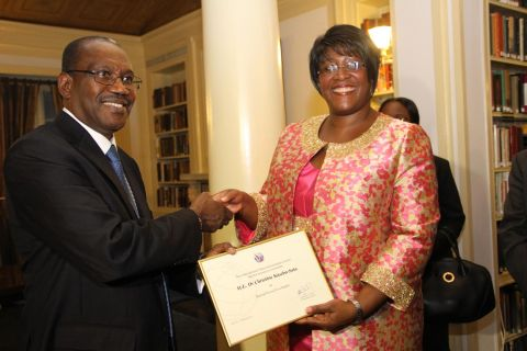 5. First Lady Dr Christine Kaseba with the International Telecommunication Union Secretary General Dr Hamadoun Toure at Yale Club Library where she was inaugurated as the ITU special Envoy for e-Health