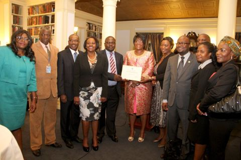 9. First Lady Dr Christine Kaseba with the International Telecommunication Union Secretary General Dr Hamadoun Toure and Zambian leaders at Yale Club Library where she was inaugurated as the ITU special Envoy for e-Health.