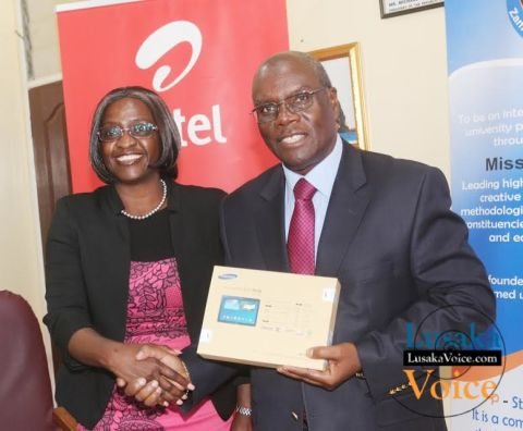 Airtel CEO Charity Chanda Lumpa and Zambia Open University Vice Chancellor Professor Mutale Musonda  showing off a tablet; Airtel and ZAOU have launched a  loan Scheme that will enable the ZOAU members of the Senate to acquire tablets that they will be paying monthly, the ceremony took place at ZOU senate boardroom off Mumbwa road in Lusaka West on Wednesday, September 24th,   2014.