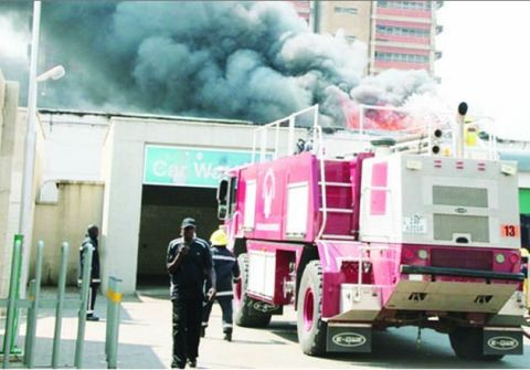 Fire fighters from Lusaka City Council, Zambia Air Force and National Airports Corporation try to put out a fire which destroyed a warehouse belonging to Pen Marks yesterday.