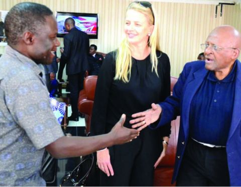 GIRLS Not Brides, founder Archbishop Desmond Tutu (right) greets Deputy Inspector General of Police Solomon Jere (left) on arrival at Kenneth Kaunda International Airport. Looking on is Princess Mabel van Oranje. Picture by CLEVER ZULU