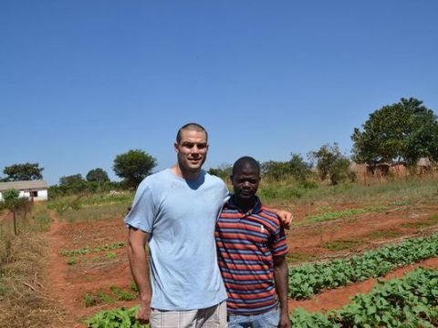 Mickey Kinzenbaw with Zambian resident Chimbaza Mbewe, who was trained by members of the Ankeny Free Church to grow his own crops. (Photo: Mickey Kinzenbaw/Special to the Register )