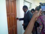 Minister of Health opening the door
