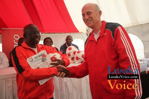 Ministry of Education and Early Childhood  PS Dr Patrick Nkanza receiving from Zanaco MD Dick Bruce some soccer balls meant to selected Lusaka based primary schools ,the ceremony took place at the ZANACO Sunset Stadium