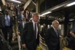 New York Mayor Bill de Blasio (C) and New York City Police Commissioner William Bratton (R) enter the City Hall subway station while on their way to give a news conference in New York September 25, 2014.