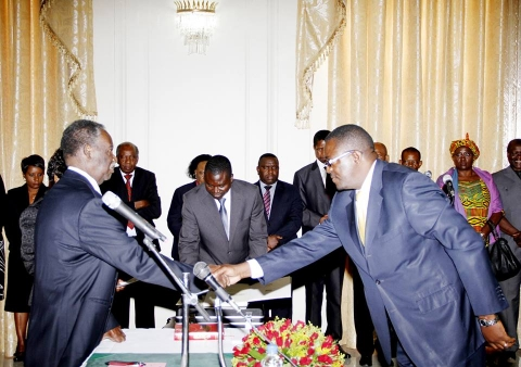 President Sata congratulates new Supreme Court Judge Mumba Malila during the swearing-in-ceremony at State House on September 1,2014 -Picture by THOMAS NSAMA