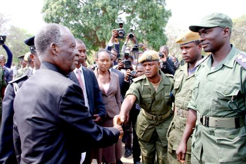 President Sata greets police officers on arrival at the National Assembly of Zambia for the opening of parliament on September 19, 2014 -Picture by THOMAS NSAMA