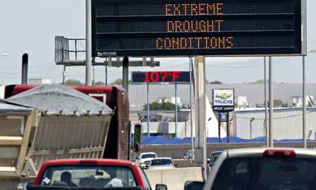 Signs warning of drought and high temperatures in Texas. The UN has predicted climate hell by 2050. Photograph: Mike Stone/Reuters