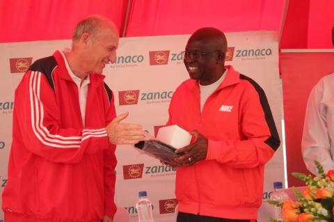 Zanaco MD Dick Bruce congratulating  the PS Dr. Patrick Nkanza voted the best player