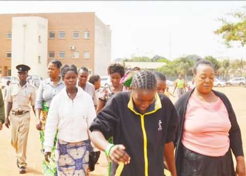 BISHOP Rose Kayanda (right), of Jesus Soul Ministries being led to Lusaka Central Prison after appearing in court accused of beating up magistrate Exildah Chanda and her husband Rabison