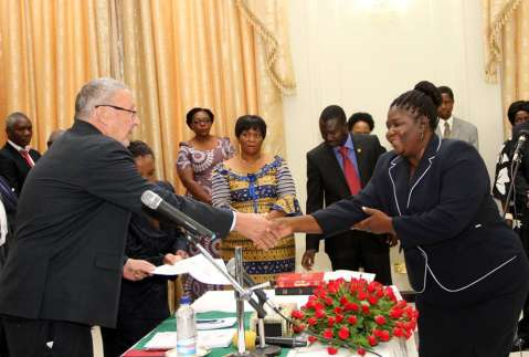 Acting President Dr Guy Scott congratulates High Court Judge Yvonne Chembe during the swearing -in-ceremony at State House on November 25,2014 -Picture by THOMAS NSAMA