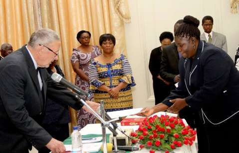Acting President Dr Guy Scott receives an affidavit of Oath from High Court Judge Yvonne Chembe during the swearing -in-ceremony at State House on November 25,2014 -Picture by THOMAS NSAMA