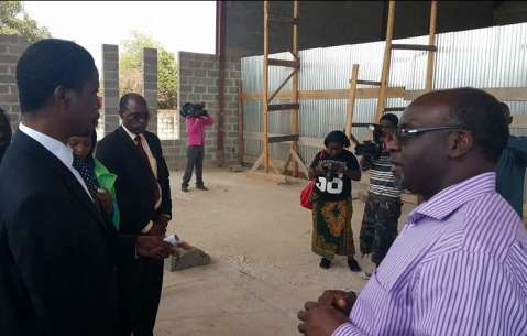 Hon Lungu touring the unfinished church building with Bishop Paul Mususu