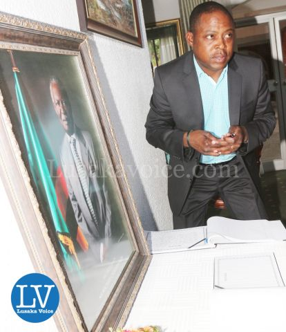 FAZ President Kalusha Bwalya; FAZ spokesperson Nkweto Tembwe sign book for SataFAZ President Kalusha Bwalya; FAZ spokesperson Nkweto Tembwe sign book for Sata
