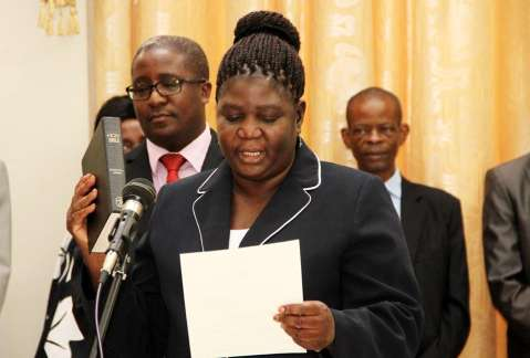 Oath from High Court Judge Yvonne Chembe during the swearing -in-ceremony at State House on November 25,2014 -Picture by THOMAS NSAMA