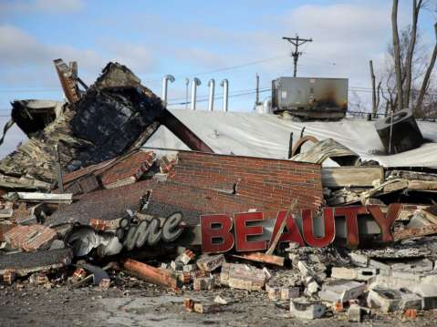 One of the buildings burned to the ground during protests after a grand jurt decided not to indict a police officer in the killing of an unarmed teenager, Nov. 25, 2014, Dellwood, Mo