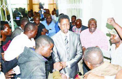 PF Secretary General Edgar Lungu surrounded by party members as he leaves Government Complex yesterday after a Central Committee meeting.