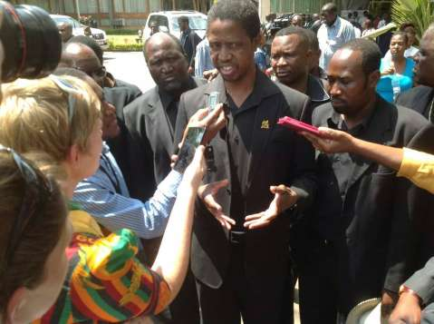 PF Secretary General Edgar Lungu talks to the media during the funeral procession.