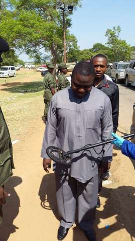 Security check is thorough. Here Minister of Foreign Affairs, Harry Kalaba goes through metal detectors.