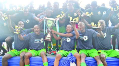 ZESCO United players celebrate after winning the 2014 Barclays Cup yesterday at Levy Mwanawasa Stadium in Ndola. Zesco beat Nkana 3-0 to lift the Barclays Cup for the fourth time. Picture by DAVID KANDUZA