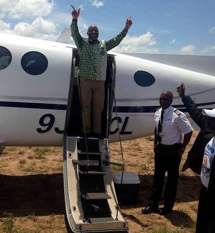 Nevers Mumba alighting from chartered airplane