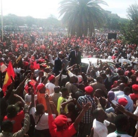 HH supporters watch him file his nomination