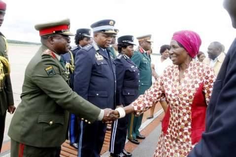 Acting President Inonge Wina greets service Chiefs after seeing- off President Lungu at Kenneth Kaunda International Airport who left for Addis Ababa, Ethiopia for the African Union Summit on January 29,2015 -Picture by THOMAS NSAMA