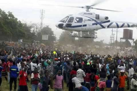 PF President Edgar Lungu leaves Mazabuka with people still crowding the Helicopter  (Picture by Salim Henry)