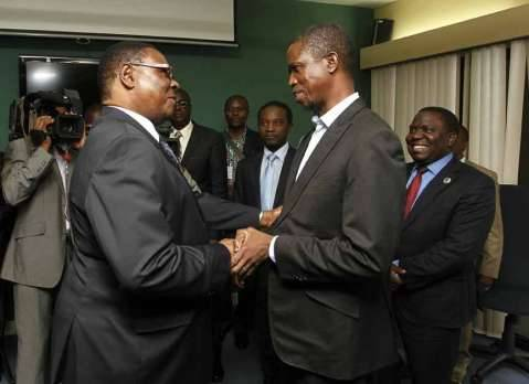 President Edgar Chagwa Lungu (right being briefed by Foreign Affairs Minister Harry Kalaba (centre) and Zambia's Ambassador to African Union Susan Sikanetta (left) before a meeting with Malawian President Professor Peter Mutharika