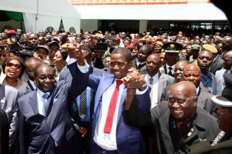 President Edgar Lungu with Zimbabwe's President Robert Mugabe and First Republican president Dr Kenneth Kaunda (r) during his Inauguration Ceremony at Heroes Stadium in Lusaka on January 25,2015 -Picture by THOMAS NSAMA