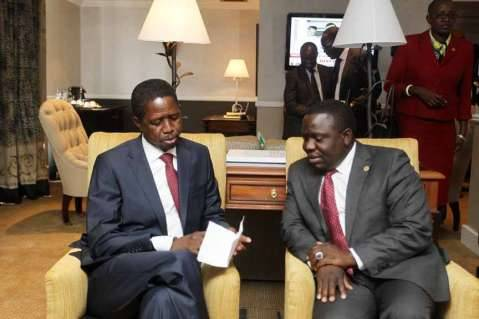 President Edgar Lungu with Foreign Affairs minister Harry Kalaba in Zimbabwe on February 6,2015 -Picture by SALIM HENRY
