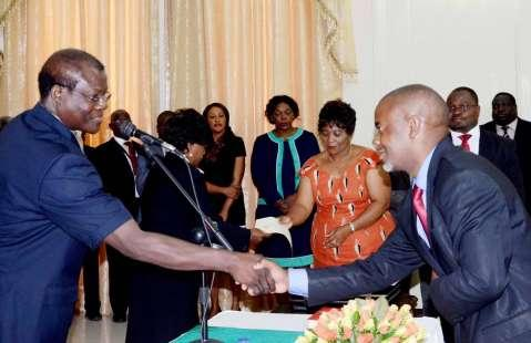 Acting President Ngosa Simbyakula congratulates Lusaka Province Permanent Secretary Stardy Mwale during the Swearing-In-Ceremony at State House on March 13,2015 -Picture by THOMAS NSAMA