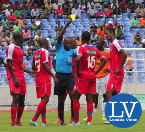 Angolan Referee Joao Amado Goma cautioning Mbabane player 15 Ndhlovu Njabulo - Photo Credit Jean Mandela - Lusakavoice.com
