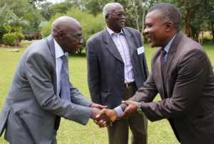 Deputy Minister of Chiefs and Traditional Affairs Hon John Akufuna with Paramount Chief Kyungu XXIV Mwakabanga III of Malawi during the official opening.