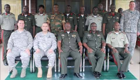 Distinguished visitors from Zambia Defense Forces and U.S. participate in a group photo during a Southern Accord 15 main planning event outside of the Zambian Ministry of Defense.(U.S. Army Africa photo by Maj. Kimbia Rey)