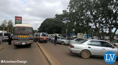 Lines for fuel in Kabulonga carry into the streets outside the filling station